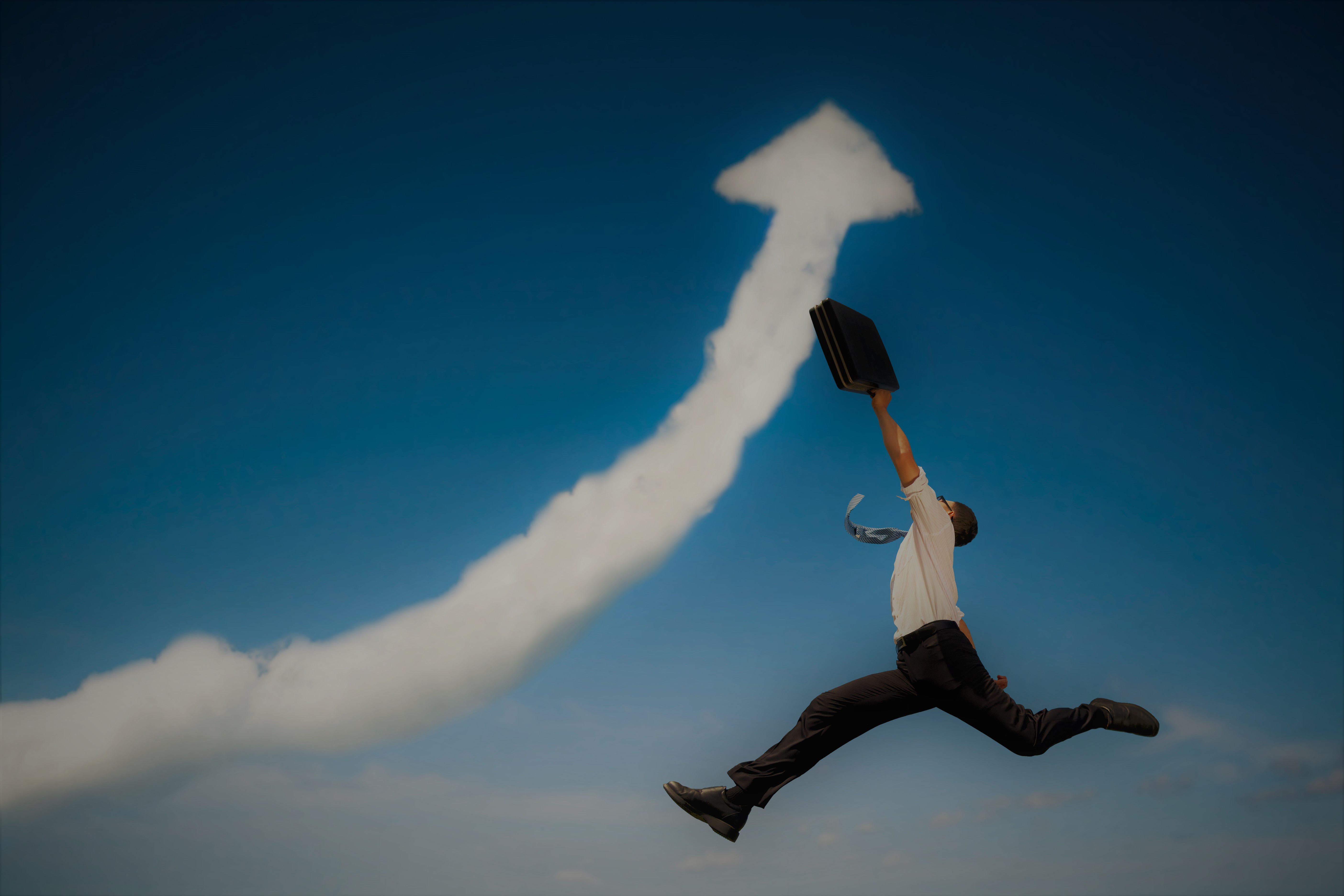 highly Successful nonfiction author jumping into cloud