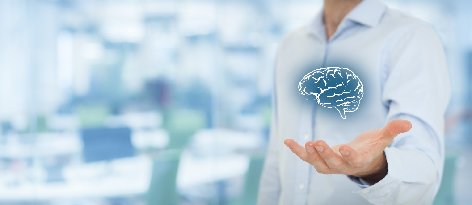 Man holding brain image in front of conference room